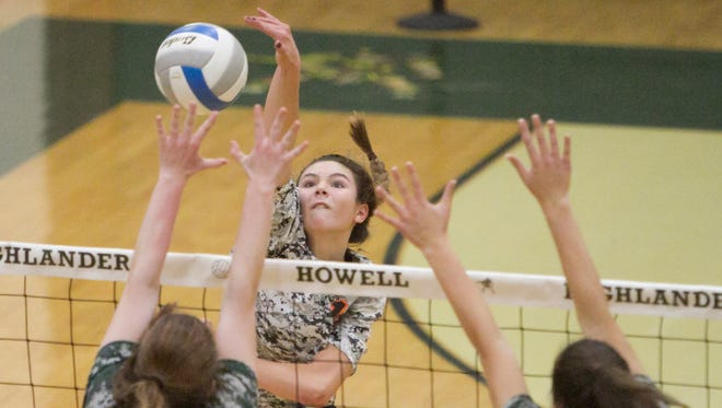 Brighton's Celia Cullen (facing camera) and Howell's Ivy Earl face off at the net.
