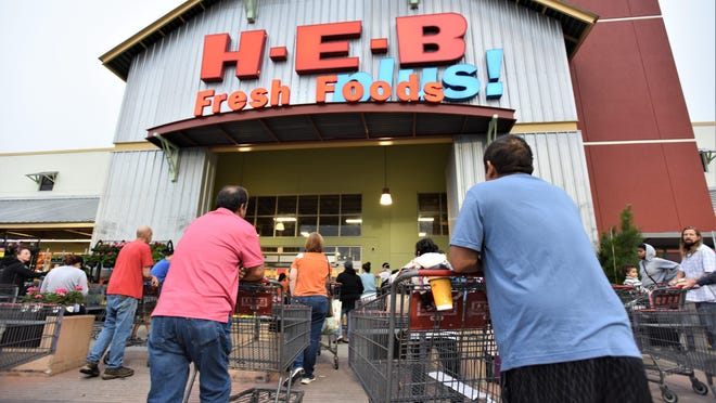Shoppers line up at a Bastrop H-E-B before an 8 a.m. opening in March.