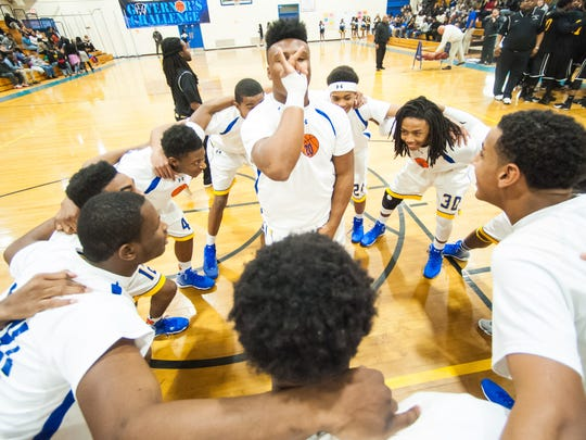 PHOTO OF THE WEEK: Wicomico guard Nelson Brown riles up the Indians before tipoff against Washington on Tuesday.