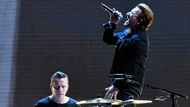 U2 lead singer Bono and drummer Larry Mullen Jr., perform before the crowd at papa John's Cardinal Stadium, Friday, Jun. 16, 2017 in Louisville Ky.