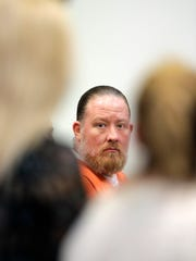 George Burch listens to statements from the family