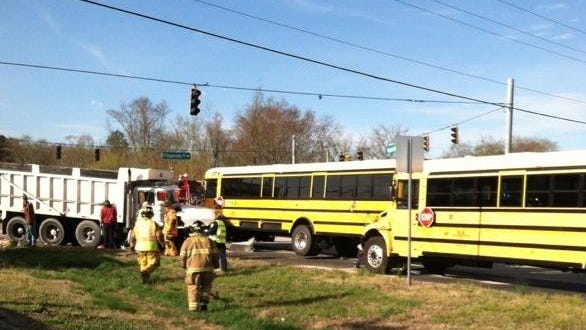 One school bus driver was injured Thursday morning in this crash involving three school buses and a dump truck, state police say.