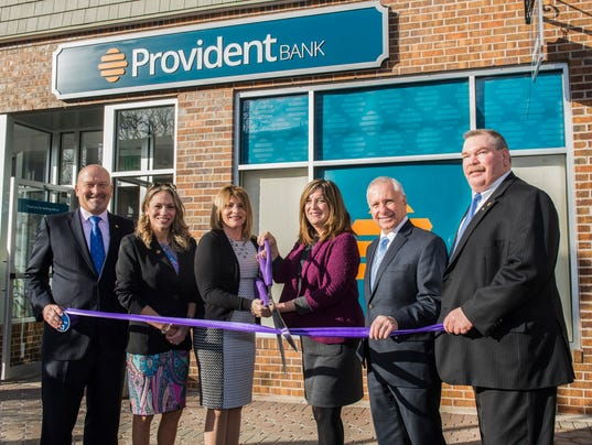 Bank celebrates relocation of branch PHOTO CAPTION