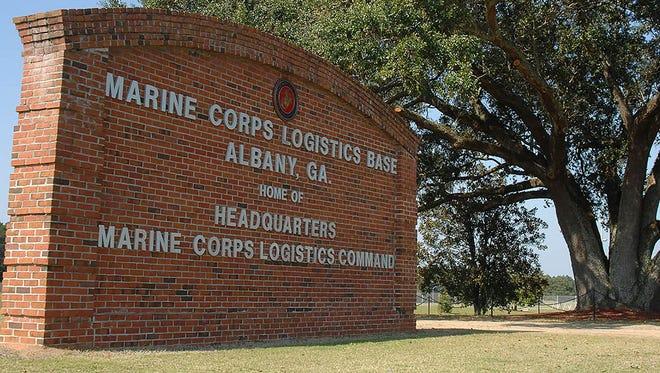 A Mississippi native and a Florida man employed by a large national trucking company were sentenced to prison for bribing officials at the Marine Corps Logistics Base in Albany, Georgia.