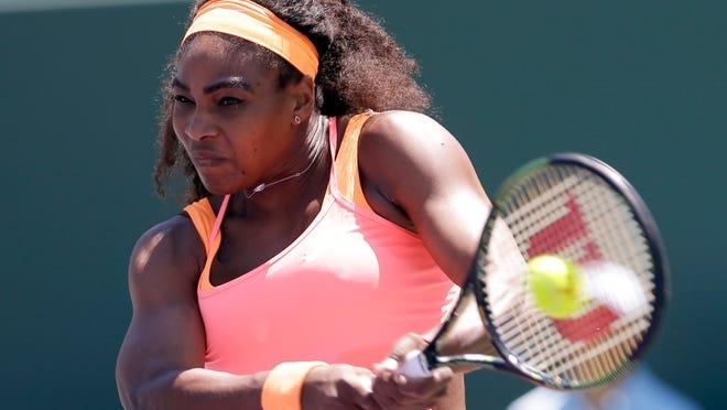 Serena Williams returns to Carla Suarez Navarro, of Spain, during the women's final at the Miami Open tennis tournament, Saturday, April 4, 2015, in Key Biscayne, Fla. (AP Photo/Alan Diaz)