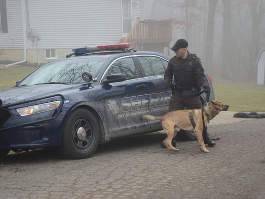 Deputy Guy Picketts Jr. and his dog Turbo prepare to search for a burglary suspect Tuesday.