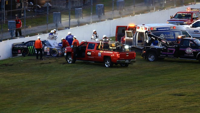 Kyle Busch is attended to by medical staff after a wreck.