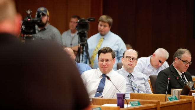 Brown County supervisors listen during public comments at a Brown County board meeting at city hall on Wednesday, July 18, 2018 in Green Bay, Wis. Members of the public spoke to the county board Wednesday as it weighed whether or not election ballots this fall will include non-binding questions about the legality of marijuana. Adam Wesley/USA TODAY NETWORK-Wisconsin
