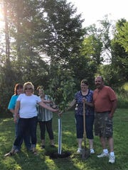The Hillis family planted an apple tree in memory of