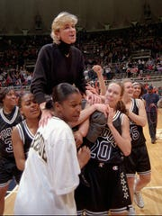 Purdue women's basketball players carry head coach Nell Fortner off the court at the Assembly Hall in Champaign, Ill. Sunday Feb. 23, 1997. Purdue defeated Illinois 80-75 earning them a share of the Big Ten Championship with Illinois.