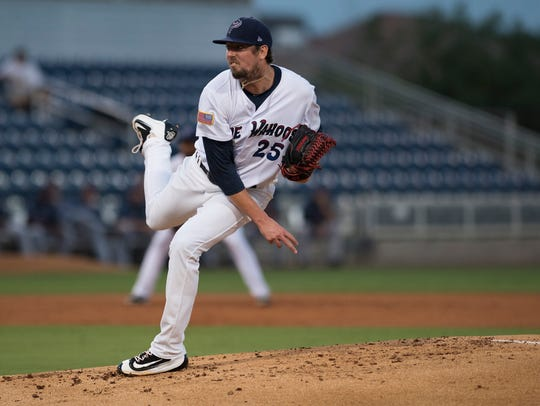 Blue Wahoos pitcher, Deck McGuire takes the mound to