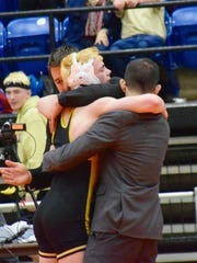 Buffalo Gap's Cullen Bendel, center, hugs head coach