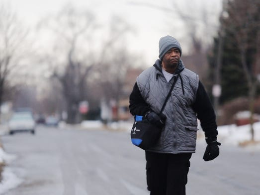 James Robertson, 56, of Detroit, walks toward Woodward