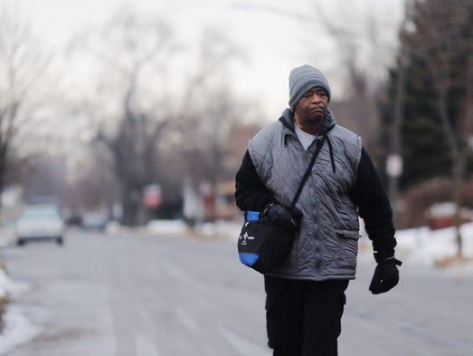 James Robertson, 56, of Detroit, walks toward Woodward