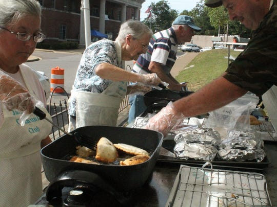 Members of the Jacks Creek Club prepare chocolate, peach and apple pies Friday at the annual Chester County BBQ Festival in Henderson.