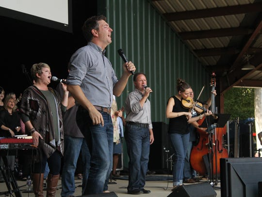 Worship Pastor Travis Cottrell and the Englewood Baptist Church choir lead the congregation in worship Sunday morning at the Casey Jones Village Amphitheater.
