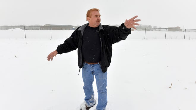 Sartell developer Ernie Wollak shows boundaries Monday, Jan. 25 on land that is part of the Eagle Ridge Estates development he owns. Wollak plans to sell about 20 acres of the land to the Sartell school district to use as part of a new Sartell High School site. The land is near the existing Oak Ridge Elementary School.