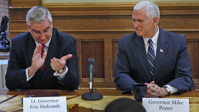 Lt. Gov. Eric Holcomb (left), Indiana's governor-elect, and Gov. Mike Pence, the vice president-elect, attend a cabinet meeting in the Statehouse on Nov. 14, 2016.