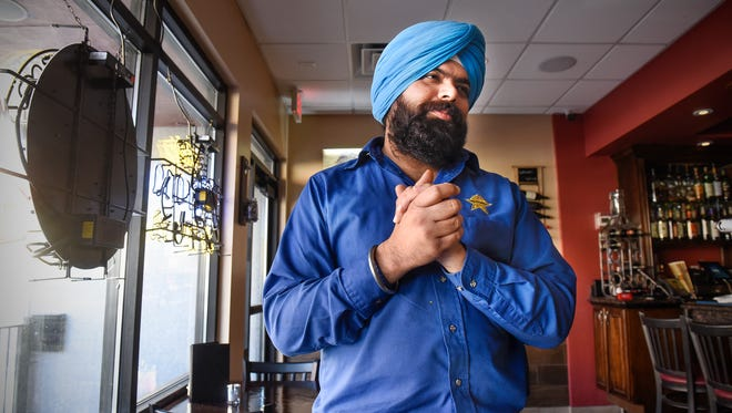Owner Kam Sidhu talks about the impact layoffs at Capitol One could possibly have on his business at Kohinoor Bar & Grill Thursday, Nov. 9, in downtown St. Cloud.