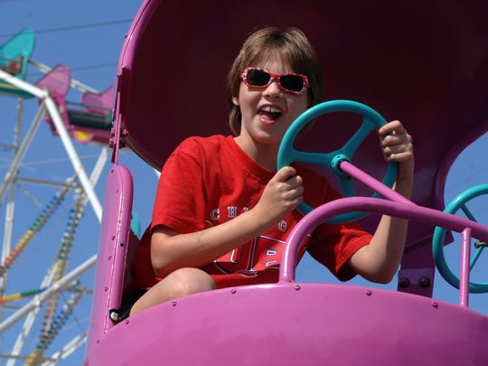 In this file photo, Katelyn Nardi, of Wausau, smiles while on the rides at the Athens Fair.