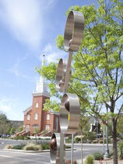 """The sculpture """"Alex,"""" by author Dan Toone, sits near an intersection in downtown St. George on Tuesday. The piece is one of two dozen outdoor sculptures included in the Art Around the Corner art show. New pieces are slated to rotate in this weekend, with the new show opening on Saturday."""