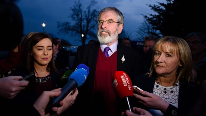 Sinn Fein leader Gerry Adams, center, talks to the media flanked by his daughter Daire, left, and Sinn Fein candidate Imelda Munster as they arrive at the Lotuh count in Dundalk, Ireland on Feb. 27, 2016, the day after the vote took place in a general election in Ireland.