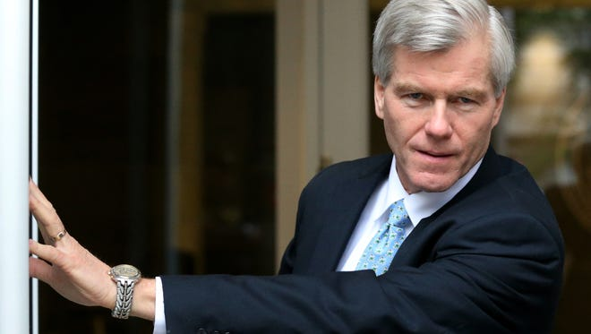 Former Virginia Gov. Bob McDonnell leaves the federal courthouse Aug. 11, 2014, in Richmond, Va., on the 11th day of the federal corruption trial of him and his wife.
