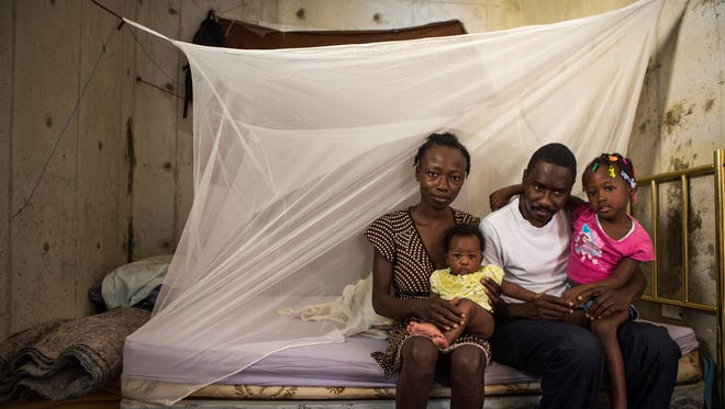 Josué Lacrète and his family in their Haut Damier village home on Dec. 11, 2014.