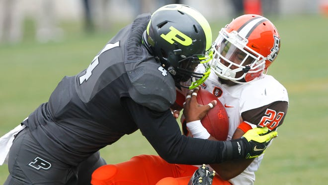 Ja'Whaun Bentley brings down Bowling Green's Fred Coppet Saturday, September 26, 2015, at Ross-Ade Stadium. Bowling Green defeated Purdue 35-28.