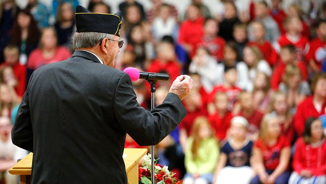 Program director Jim Otto talks to students and staff of Brandon Elementary School during a Veterans Day ceremony Wednesday.