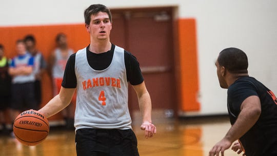 Hanover senior guard Kyle Krout runs a play at practice