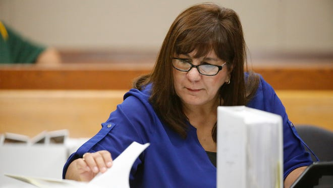 Anna Luisa Kell, a former assistant principal at Bowie High School, goes through some files Tuesday during the second day of hearings. Kell is one of three former school administrators who on Tuesday were at a hearing fighting sanctions or the revocation of their education credentials over their alleged involvement in the EPISD cheating scheme.