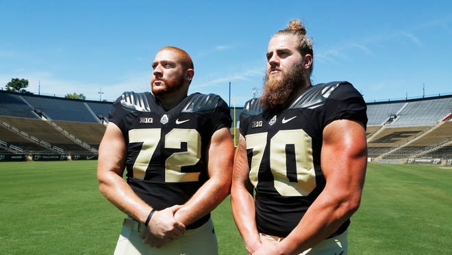 Jason King, left, and Jordan Roos strike a pose during Purdue football media day Sunday, August 7, 2016, at Ross-Ade Stadium.