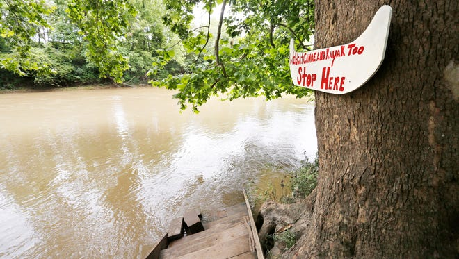 Fast moving water in the Wildcat Creek pushes a dock onto the creek's edge Monday, July 10, 2017, at the take out point for Wildcat Canoe and Kayak Too, 1850 N. 725 East. Business has been down this year due to continued high water on nearby Wildcat Creek.