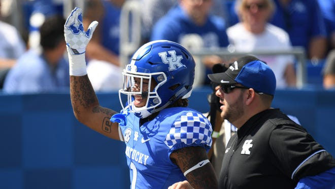 UK WR Lynn Bowden Jr. acknowledges fans after being ejected for targeting during the University of Kentucky football game against Eastern Kentucky University in Lexington, KY on Saturday, September 9, 2017.