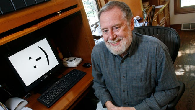 """Prof. Scott E. Fahlman is shown in his home office on Monday, Sept. 17, 2007, in Pittsburgh. Twenty-five years ago, three keystrokes -- a colon followed by a hyphen and a parenthesis --were first used as a horizontal """"smiley face"""" in a computer message by Fahlman, Carnegie-Mellon University said."""