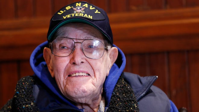Clarence Lawson Close, a 102-year-old Pearl Harbor veteran, attends the Pearl Harbor Day Observance ceremonies Thursday, December 7, 2017, in the Big Four Depot at Riehle Plaza in downtown Lafayette. Close served in the U.S. Navy in WWII aboard the USS Washington.