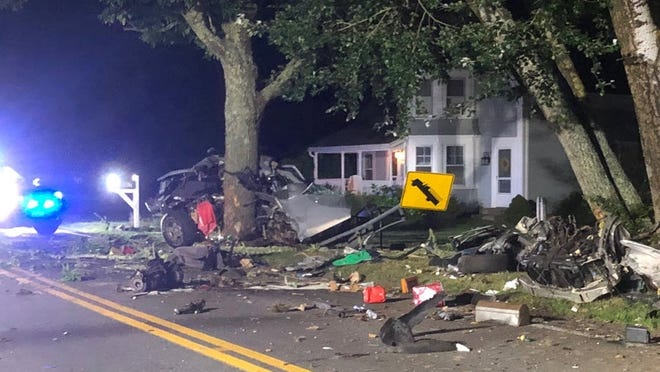 Debris litters the road where a speeding car struck a tree along Old Main Street near River Street in South Yarmouth late Thursday night. The driver was declared dead at the scene.