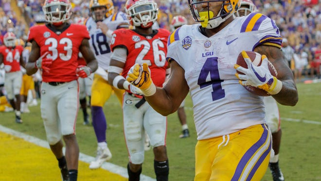LSU running back Nick Brossette (4) scores a touchdown against against Georgia during the second half of an NCAA college football game in Baton Rouge, La., Saturday, Oct. 13, 2018. (AP Photo/Matthew Hinton)