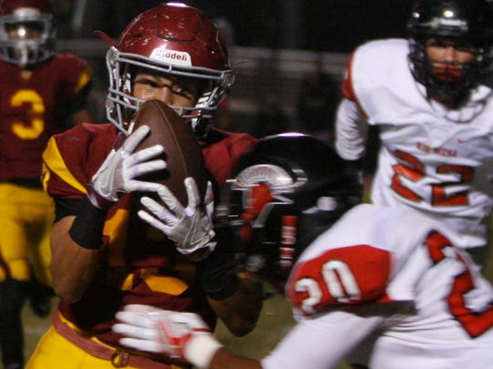 Oxnard receiver Marquis Allen (left) has the ball knocked away as he takes a hard hit from Rio Mesa High cornerback Tavias James in Friday's game. 10/14/16 Oxnard, CA