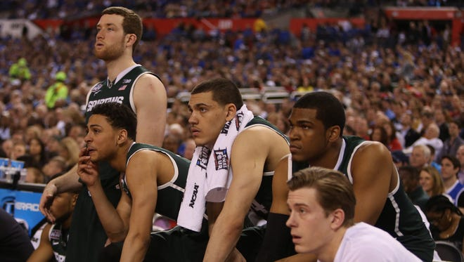 Michigan State players on the bench during the final seconds of the 81-61 loss to the Duke Blue Devils in  the NCAA Semi Final game on Saturday, April 4,2015 at Lucas Oil Stadium in Indianapolis Indiana.