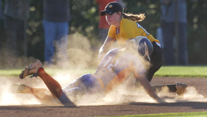 Crescent second baseman Ashley Parnell tags out HanahanÕs Jorden Fabian stealing second during the top of the third inning of game one, in the Class AAA State Championship series, at Crescent High School in Iva on Monday.