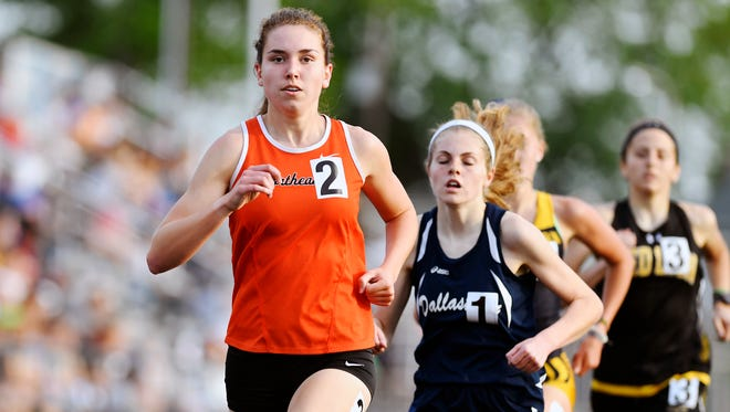 Northeastern's Maddie Warrender leads the pack to win the 1600-meter race in the 2018 YAIAA Track and Field Championships Friday, May 11, 2018, at Dallastown.