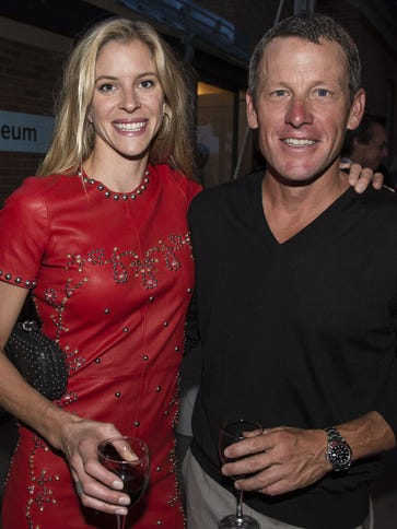 In a file photo from 2013, Anna Hansen and Lance Armstrong