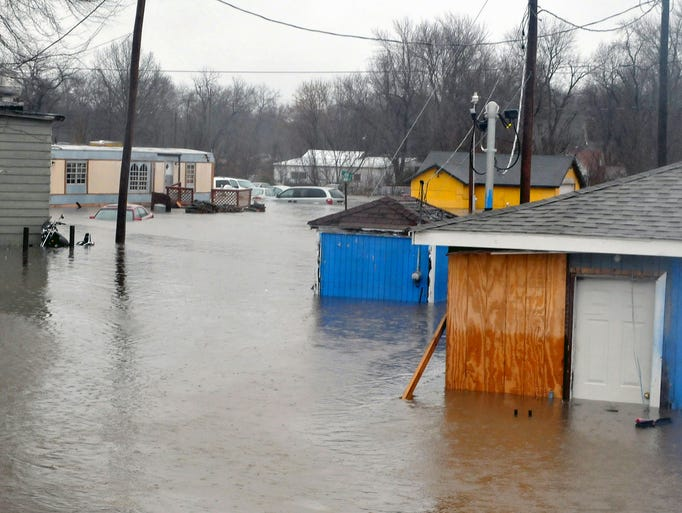 Spring River floods homes in Kendricktown, Mo., Dec.