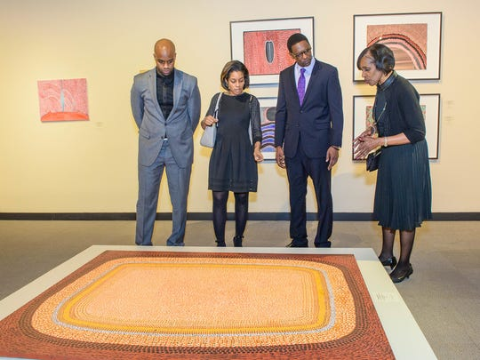 "Visitors explore the exhibition ""No Boundaries,"" works of contemporary Aboriginal painting from Australia, at the Charles H. Wright Museum of African American HIstory."