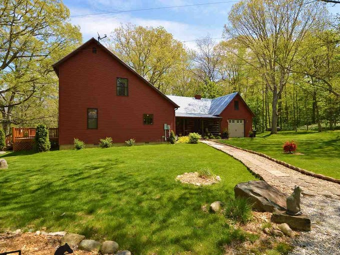 This unique saltbox home with a country flair sits