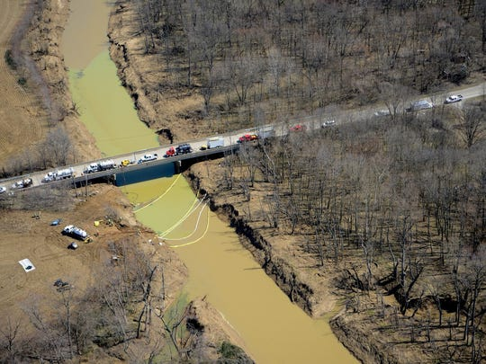 Emergency crews at the site of a Marathon Petroleum diesel spill on March 21. The Environmental Protection Agency estimates that about 42,000 gallons of diesel were released into Big Creek near Solitude, Ind.