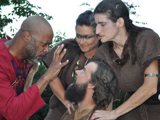 King Claudius (Brace Evans, left) threatens the defiant Prince Hamlet (Dillon Porter), who is restrained by two shield maidens (Christa Holbrook and Deena Lien Richards).