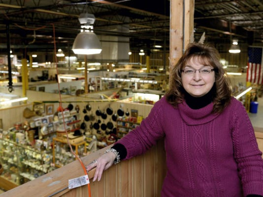 Sandy Adams, owner of Black Swan Antiquities in Annville, poses for a picture in her office that overlooks the floor of the building on Tuesday. Adams found out Tuesday morning that PinnacleHealth purchased the building and plans to turn it into a medical center.